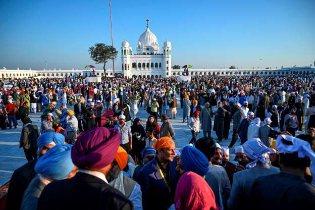 Slide 50 of 120: Sikh pilgrims visit the Shrine of Baba Guru Nanak Dev at Gurdwara Darbar Sahib in Kartarpur, near the Indian border, on November 9, 2019. - Hundreds of Indian Sikhs made a historic pilgrimage to Pakistan on November 9, crossing through a white gate to reach one of their religion's holiest sites, after a landmark deal between the two countries separated by the 1947 partition of the subcontinent. (Photo by AAMIR QURESHI / AFP) (Photo by AAMIR QURESHI/AFP via Getty Images)