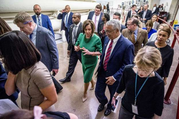 Slide 59 of 85: House Speaker Nancy Pelosi of Calif., right, and Education and Labor Committee Chairman Rep. Bobby Scott, D-Va., left, speak as they leave a news conference to unveil the College Affordability Act on Capitol Hill in Washington, Tuesday, Oct. 15, 2019.