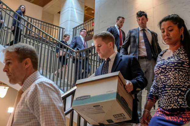 Slide 62 of 85: A congressional aide carries a box of documents following Rep. Jim Jordan (R-OH) (R) on Capitol Hill on October 14, 2019 in Washington, DC. Fiona Hill, former Special Assistant to U.S. President Donald Trump and Senior Director for European and Russian Affairs on the  National Security Council, is expected to testify Monday in connection with the House impeachment inquiry of President Trump.