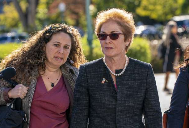 Slide 65 of 85: Former U.S. ambassador to Ukraine Marie Yovanovitch, left, arrives on Capitol Hill, Friday, Oct. 11, 2019, in Washington, as she is scheduled to testify before congressional lawmakers on Friday as part of the House impeachment inquiry into President Donald Trump.