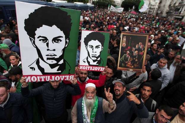 Slide 75 of 120: Demonstrators take to the streets in the capital Algiers to protest against the government and reject the upcoming presidential elections, in Algeria, Friday, Nov. 8, 2019. (AP Photo/Fateh Guidoum)