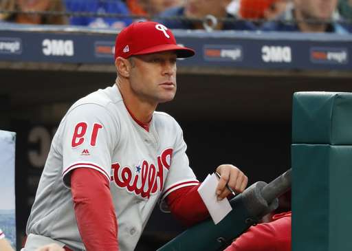 a baseball player holding a bat: FILE - In this July 23, 2019, file photo, Philadelphia Phillies manager Gabe Kapler watches the team play the Detroit Tigers in the first inning of a baseball game in Detroit. Kapler is new manager of the San Francisco Giants, replacing Bruce Bochy, who retired when the season ended. The Giants made the announcement late Tuesday, Nov. 12, and planned a formal introduction to follow. The 44-year-old Kapler was fired Oct. 10 after two seasons in Philadelphia and a 161-163 record. (AP Photo/Paul Sancya, File)