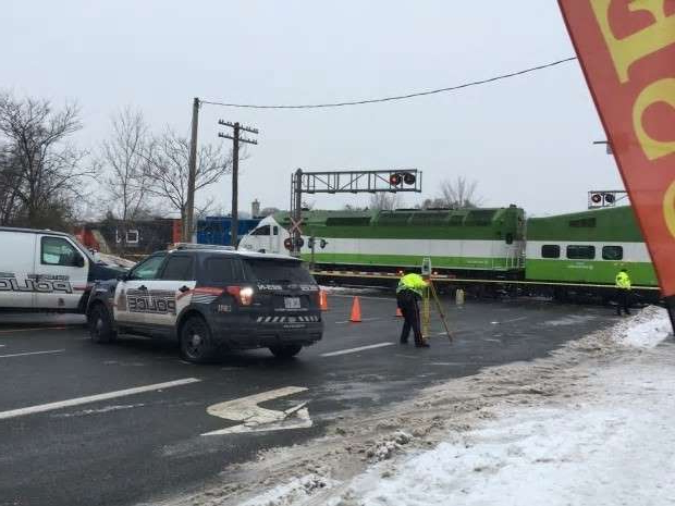 a group of people riding on the back of a truck: Waterloo Regional Police investigate Thursday afternoon after pedestrians were hit by a GO Train.