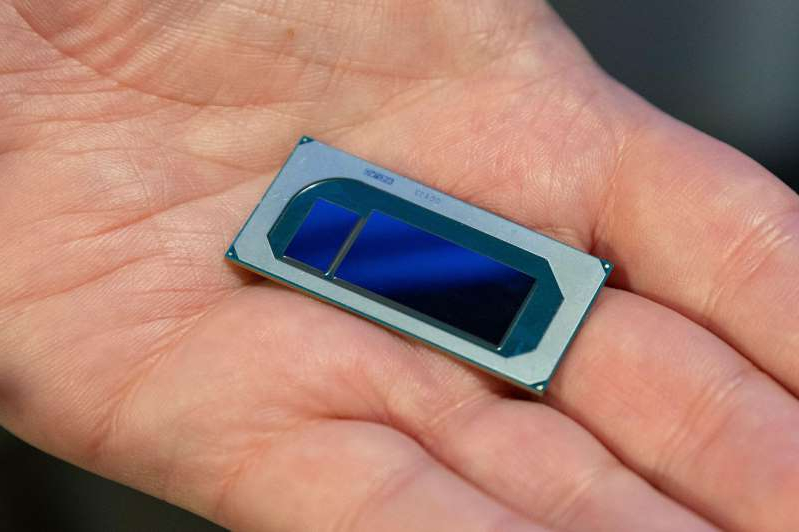 a hand holding a cellphone: Intel's Nervana NNP-I chips are designed to be crammed into data centers for AI tasks like translating text or analyzing photos.