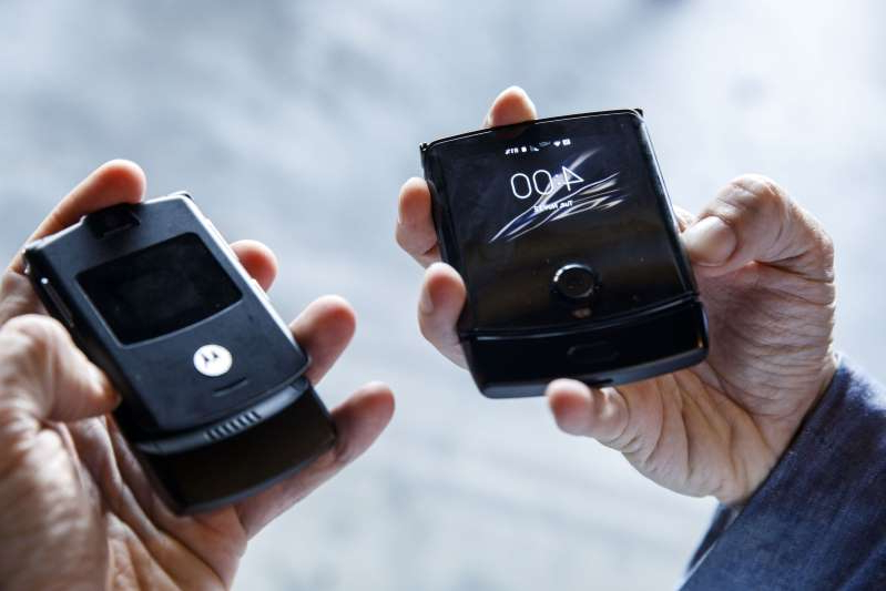 a hand holding a cellphone: Motorola Brings Back The Razr As $1,500 Foldable Smartphone