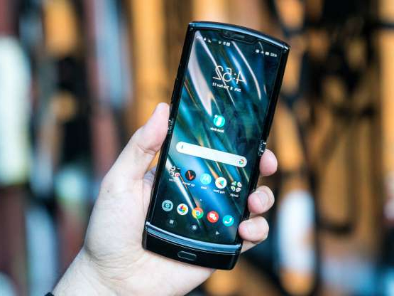 a hand holding a cellphone: Opened up, the new Razr is a pretty typical smartphone with a 6.2-inch screen.