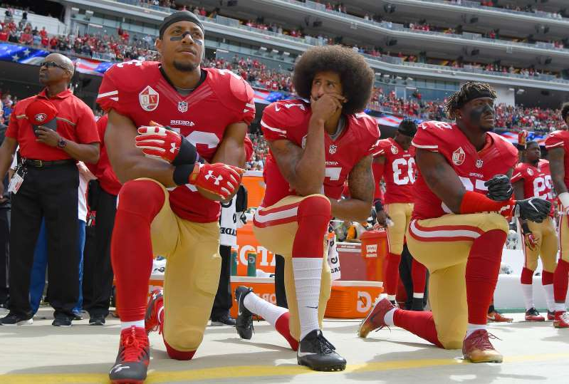 Eric Reid et al. wearing costumes: Eric Reid, right, has been a friend an ally of Colin Kaepernick's throughout his ordeal with the NFL since they were 49ers teammates. (Thearon W. Henderson/Getty Images)