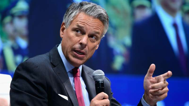Jon Huntsman wearing a suit and tie talking on a cell phone: Jon Huntsman expected to run for governor in Utah