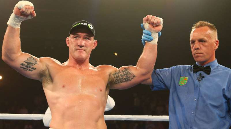 Paul Gallen holding his hands up: After beating John Hopoate, moving to 9-0.