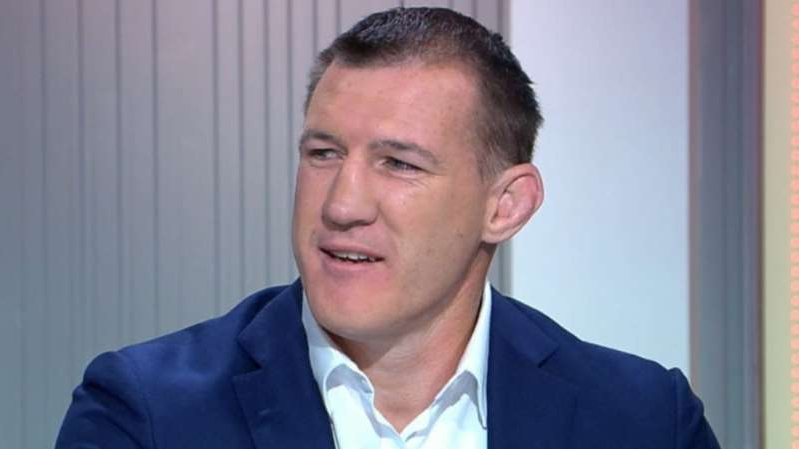 Paul Gallen wearing a suit and tie smiling at the camera: Paul Gallen says he intends to end Barry Hall's boxing career before it begins in their Melbourne fight.