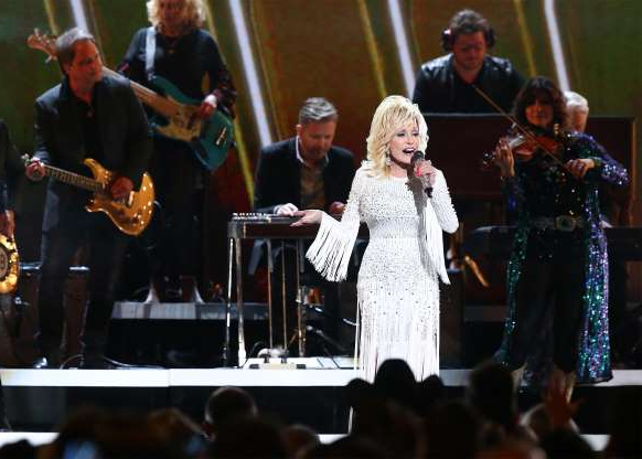 Slide 14 of 18: NASHVILLE, TENNESSEE - NOVEMBER 13: (FOR EDITORIAL USE ONLY) Dolly Parton performs onstage during the 53rd annual CMA Awards at the Bridgestone Arena on November 13, 2019 in Nashville, Tennessee. (Photo by Terry Wyatt/Getty Images)