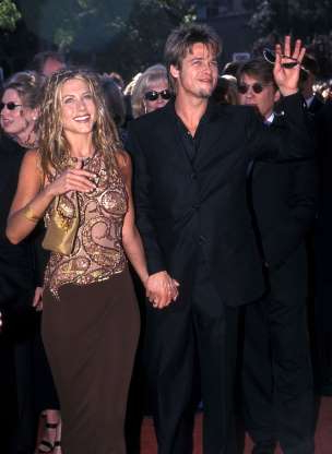 Slide 14 of 63: Actor Brad Pitt and actress Jennifer Aniston attend the 51st Annual Primetime Emmy Awards on September 12, 1999 at Shrine Auditorium in Los Angeles, California. (Photo by Ron Galella, Ltd./Ron Galella Collection via Getty Images)