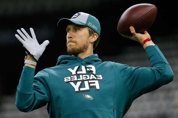 Slide 16 of 51: NEW ORLEANS, LOUISIANA - JANUARY 13: Nick Foles #9 of the Philadelphia Eagles warms up before the NFC Divisional Playoff against the New Orleans Saints at the Mercedes Benz Superdome on January 13, 2019 in New Orleans, Louisiana. (Photo by Jonathan Bachman/Getty Images)