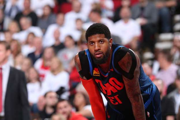 Slide 19 of 51: PORTLAND, OR - APRIL 23: Paul George #13 of the Oklahoma City Thunder looks on against the Portland Trail Blazers during Game Five of Round One of the 2019 NBA Playoffs on April 23, 2019 at the Moda Center in Portland, Oregon. NOTE TO USER: User expressly acknowledges and agrees that, by downloading and or using this Photograph, user is consenting to the terms and conditions of the Getty Images License Agreement. Mandatory Copyright Notice: Copyright 2019 NBAE (Photo by Sam Forencich/NBAE via Getty Images)