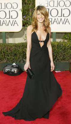 Slide 24 of 63: BEVERLY HILLS, CA - JANUARY 25: Actress Jennifer Aniston attends the 61st Annual Golden Globe Awards at the Beverly Hilton Hotel on January 25, 2004 in Beverly Hills, California. (Photo by Carlo Allegri/Getty Images)