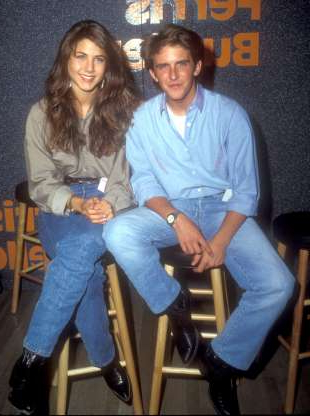 Slide 3 of 63: Charlie Schlatter and Jennifer Aniston (Photo by Barry King/WireImage)