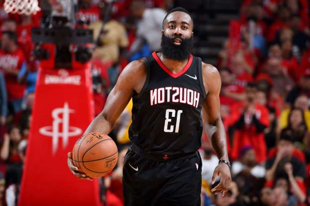 Slide 32 of 51: HOUSTON, TX - MAY 14:  James Harden #13 of the Houston Rockets looks on against the Golden State Warriors during Game One of the Western Conference Finals of the 2018 NBA Playoffs on May 14, 2018 at the Toyota Center in Houston, Texas. NOTE TO USER: User expressly acknowledges and agrees that, by downloading and or using this photograph, User is consenting to the terms and conditions of the Getty Images License Agreement. Mandatory Copyright Notice: Copyright 2018 NBAE (Photo by Andrew D. Bernstein/NBAE via Getty Images)