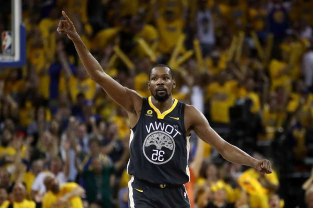 Slide 42 of 51: OAKLAND, CA - JUNE 03:  Kevin Durant #35 of the Golden State Warriors reacts against the Cleveland Cavaliers in Game 2 of the 2018 NBA Finals at ORACLE Arena on June 3, 2018 in Oakland, California. NOTE TO USER: User expressly acknowledges and agrees that, by downloading and or using this photograph, User is consenting to the terms and conditions of the Getty Images License Agreement.  (Photo by Ezra Shaw/Getty Images)