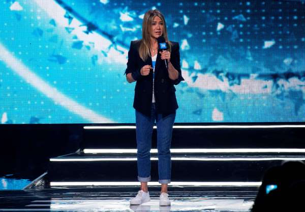 Slide 57 of 63: Actress Jennifer Aniston speaks on stage at the WE Day California at The Forum, in Inglewood, California, on April 19, 2018. (Photo by VALERIE MACON / AFP)        (Photo credit should read VALERIE MACON/AFP/Getty Images)