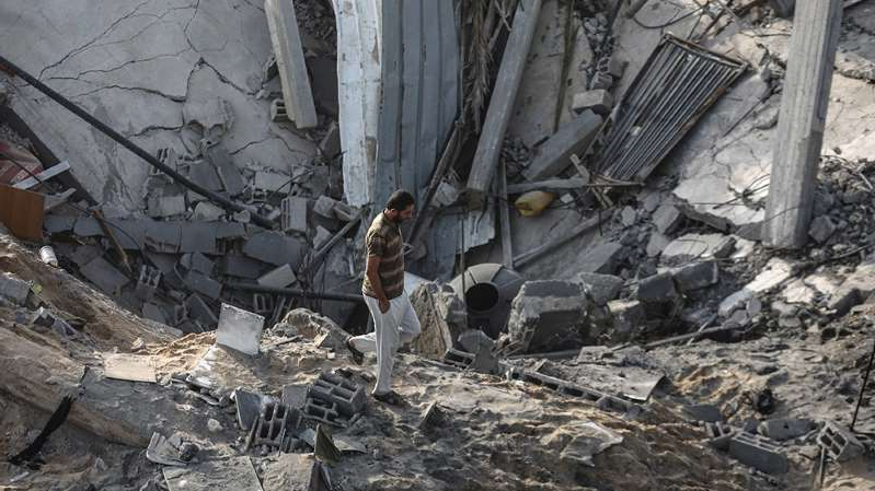 a pile of dirt: A ceasefire in Gaza was looking shaky as Israel renewed raids targeting Islamic Jihad after it said rockets were fired from the besieged territory. [Amir Cohen/Reuters]