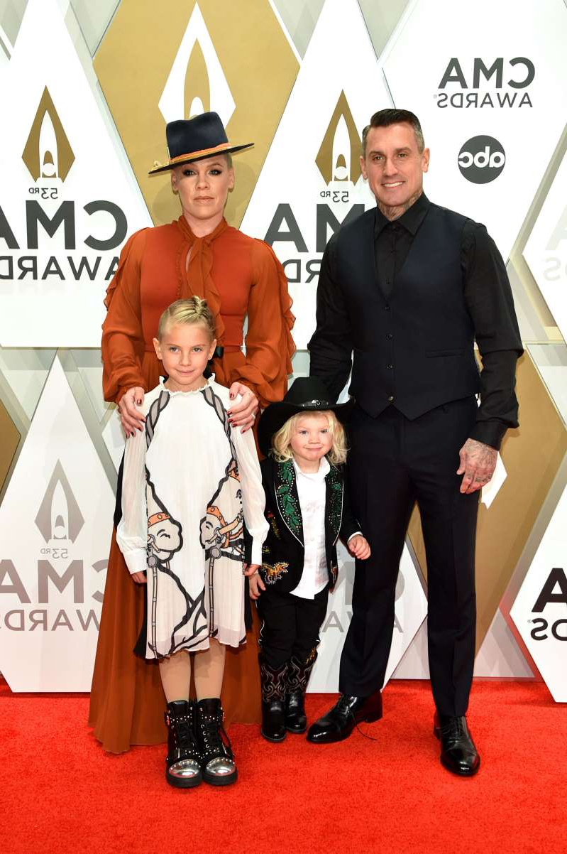 Carey Hart, Pink posing for a photo: Pink attends the 53rd annual CMA Awards with husband Carey Hart and children Jameson and Willow Hart on Nov. 13, 2019, in Nashville, Tennessee.