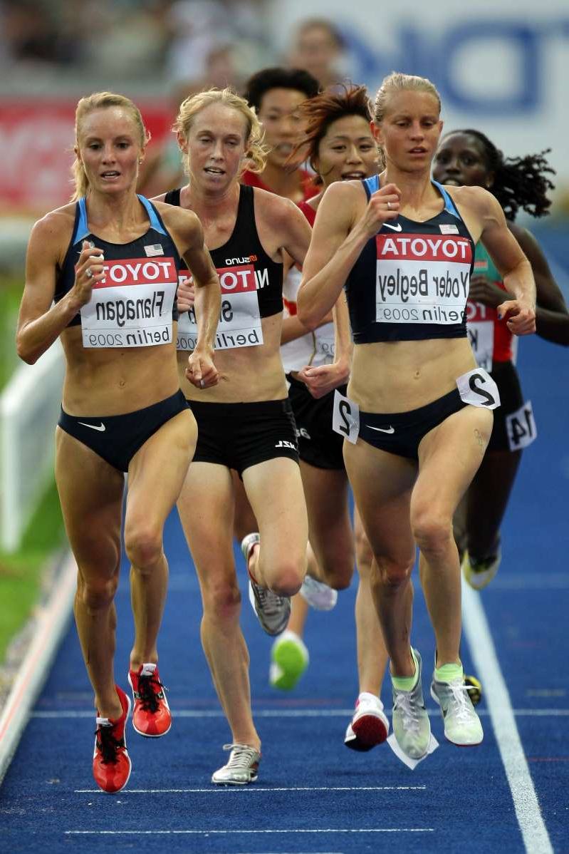 (L-R) Amy Yoder Begley of United States and Shalane Flanagan of United States compete in the women's 10,000 Metres Final during day one of the 12th IAAF World Athletics Championships at the Olympic Stadium on August 15, 2009 in Berlin, Germany.