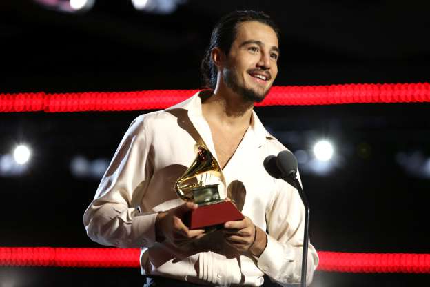 Slide 26 of 35: Tiago Iorc accepts the award for Best Portuguese Language Song onstage at the Premiere Ceremony during the 20th annual Latin GRAMMY Awards at MGM Grand Garden Arena on November 14, 2019 in Las Vegas, Nevada. (Photo by Greg Doherty/Getty Images for LARAS)