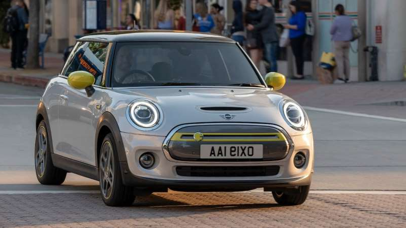 a car parked on the side of a road: 2020 Mini Cooper SE front three quarter