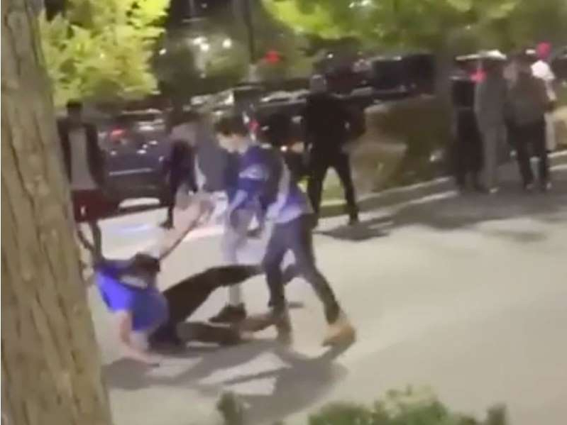 a group of people walking down the street: This is a screen grab from a video that surfaced in August of Surrey youth brawling in the Strawberry Hill neighbourhood. Another video of youth fighting posted Thursday has prompted the mayor to speak out about the mob violence.