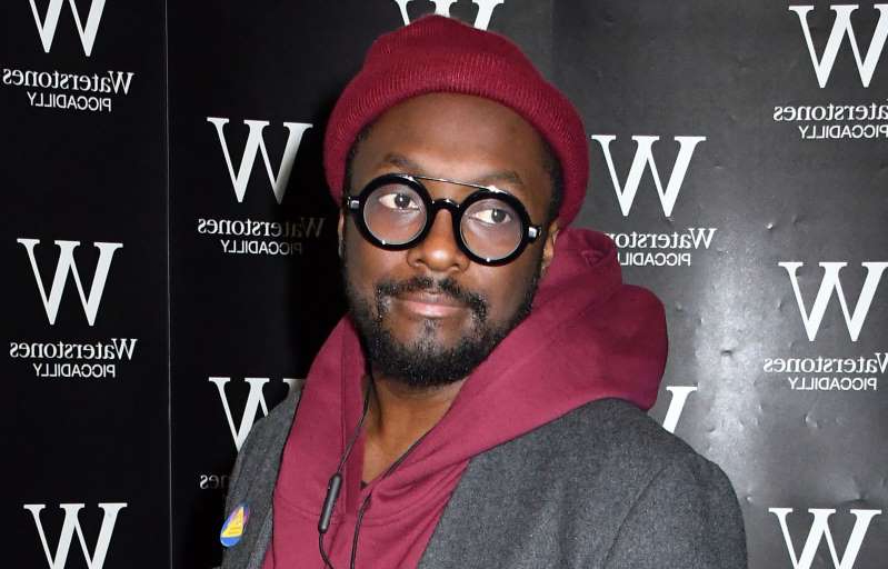 a man wearing a hat and glasses: will.i.am - Nils Jorgensen/Shutterstock