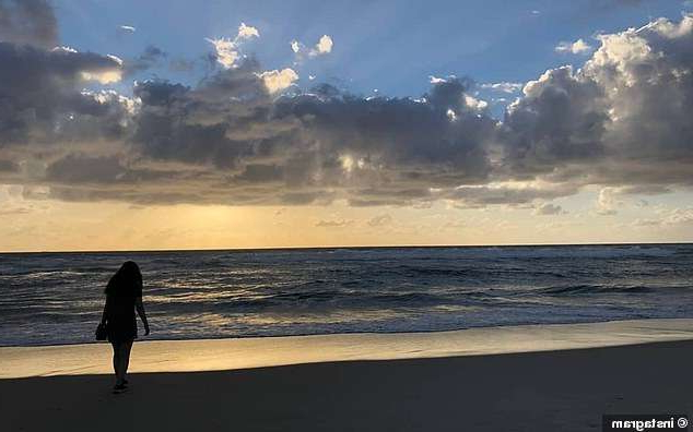 a person standing on a beach: Other images showed people watching the sunrise over Tallows Beach on June 1 (pictured)