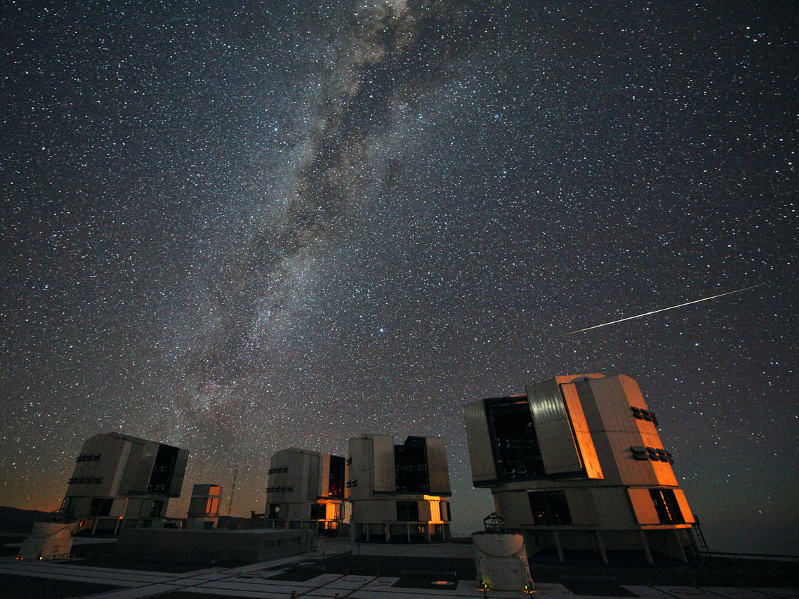a traffic light on a city street: A Perseid meteor streaks past the Paranal Observatory in Chile, August 2010.