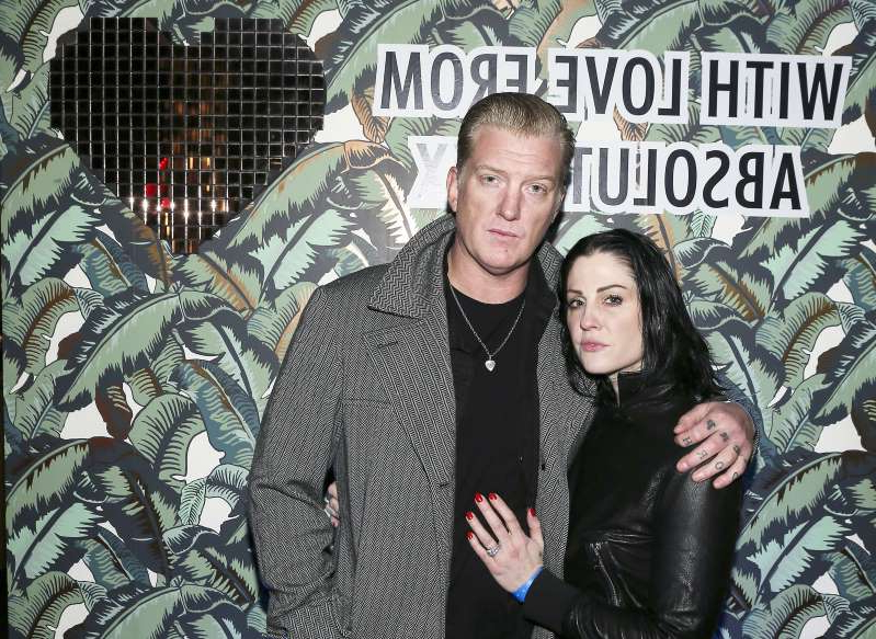Brody Dalle, Joshua Homme posing for a picture: Josh Homme and his Brody Dalle-Homme attend Mark Ronson's 'Club Heartbreak' Grammy Party, sponsored by Absolut Elyx, in Ls Angeles on Feb. 10, 2019.