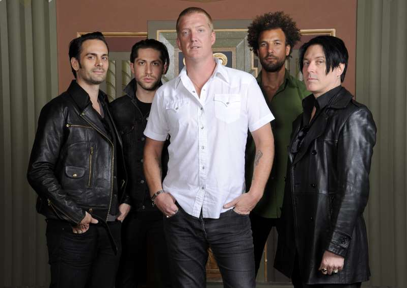 Jon Theodore, Joshua Homme, Michael Shuman, Dean Fertita posing for the camera: Troy Van Leeuwen, Jon Theodore, Josh Homme, Michael Shuman and Dean Fertita of Queens of the Stone Age pose for a portrait at the Wiltern Theatre in Los Angeles.