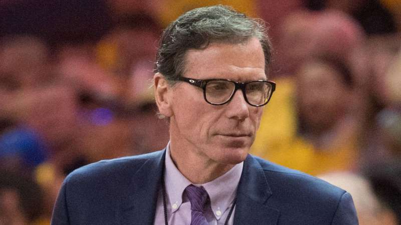 Kiki Vandeweghe wearing glasses and a suit and tie