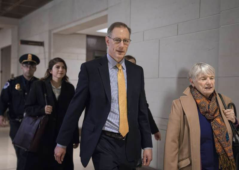 Mark Sandy, a career employee in the White House Office of Management and Budget, arrives at the Capitol to testify in the impeachment inquiry on Nov. 16, 2019.
