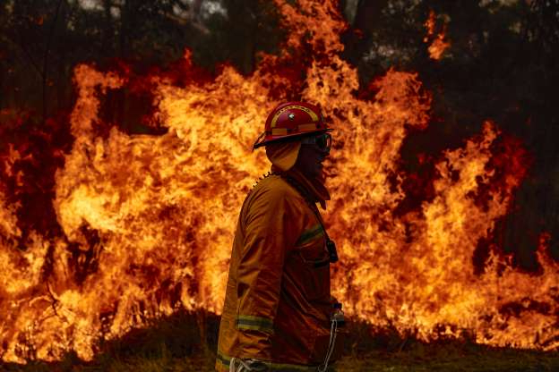 Slide 1 of 40: SYDNEY, AUSTRALIA - NOVEMBER 14: A CFA Member works on controlled back burns along Putty Road on November 14, 2019 in Sydney, Australia. Crews are working hard to gain the upper hand after devastating fires tore through areas near Colo Heights. Bushfires from the Gospers Mountain bushfire continue to burn. An estimated million hectares of land has been burned by bushfire following catastrophic fire conditions - the highest possible level of bushfire danger. While conditions have eased, fire crews remain on high alert as dozens of bushfires continue to burn. A state of emergency was declared by NSW Premier Gladys Berejiklian on Monday 11 November and is still in effect, giving emergency powers to Rural Fire Service Commissioner Shane Fitzsimmons and prohibiting fires across the state. (Photo by Brett Hemmings/Getty Images)