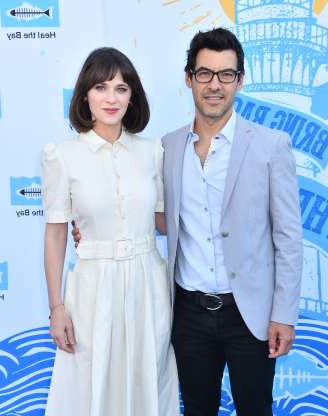 Slide 14 of 117: On Sept. 6, actress Zooey Deschanel and film producer Jacob Pechenik announced that they'd split after four years of marriage and two kids together.