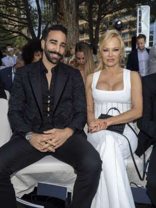 Slide 36 of 117: It's over for Pamela Anderson and her French soccer star boyfriend of two years, Adil Rami, who's nearly 19 years her junior. The
