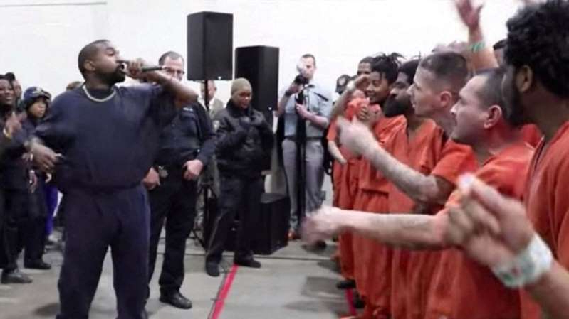 a group of people standing in front of a crowd: Kanye West performed two shows at Harris County jail in Texas