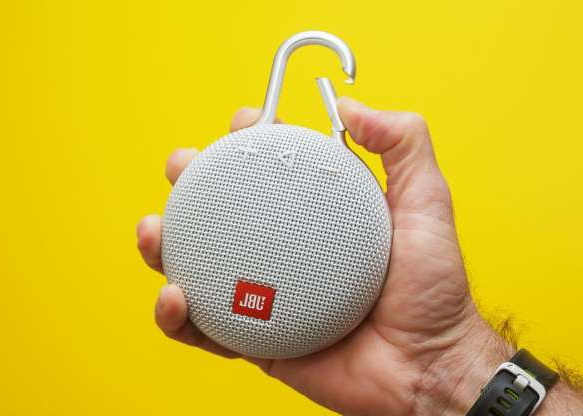 a hand holding a yellow object: The JBL Clip 3 is a better-sounding version of one of our favorite micro Bluetooth speakers.