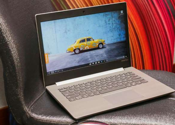 a laptop computer sitting on top of a table: When Lenovo introduced the IdeaPad 330s last year, it started at $500. Now, you can get a decent midrange configuration -- with a quad-core AMD processor, a 256GB SSD and 8GB of RAM -- for about $350. Equipped with a good-looking 15.6-inch display, the 330s has thinner-than-usual bezels and an aluminum lid. This is a good deal on a solid entry-level laptop. Read our Lenovo IdeaPad 330s preview.