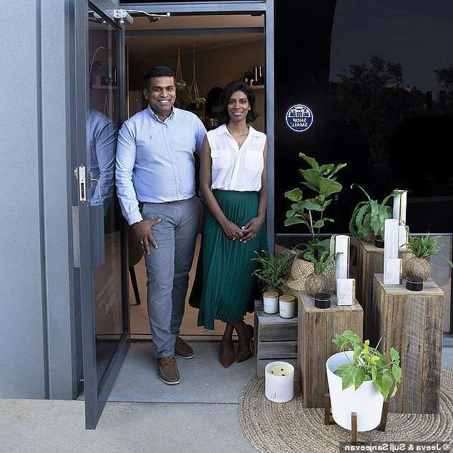 a man and a woman standing in front of a building: Currently on the website they are selling 'yoga-inspired' candles for $28, aromatherapy room spray for $19.95 and organic hand and body wash for $29.95