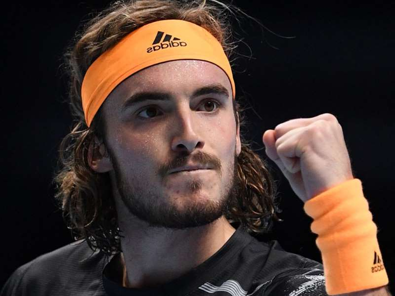 a man wearing a hat: Stefanos Tsitsipas stunned six-time ATP Finals champion Roger Federer to reach the biggest final of his career
