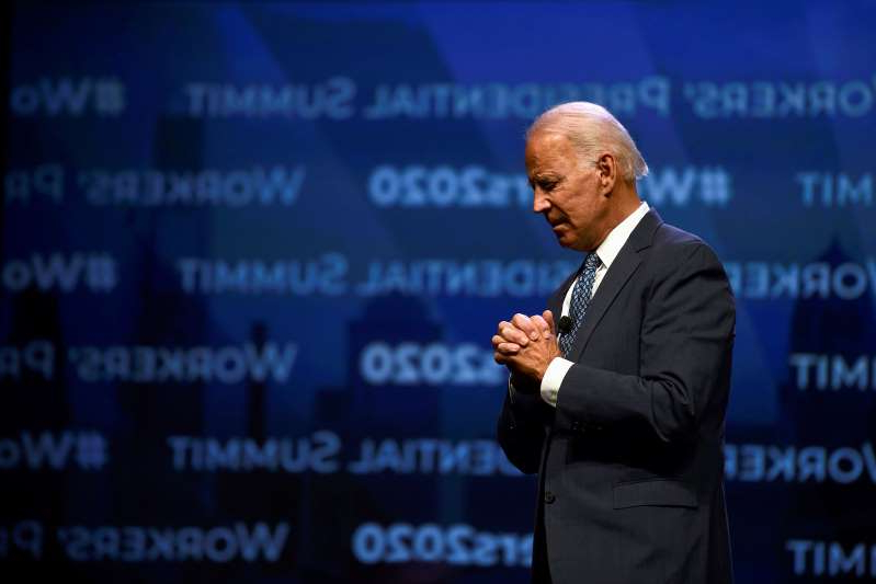 a man wearing a suit and tie: Image: Former U.S. Vice President Joe Biden addresses attendees during the AFL-CIO Workers Presidential Summit in Philadelphia