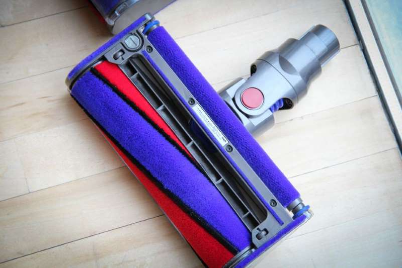 a piece of luggage sitting on top of a suitcase: The Dyson V8 Animal is one of the company's stick vacs getting a deep discount. Luke Westaway/CNET