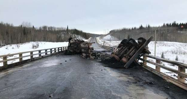 a wooden bench covered in snow: On Saturday Nov. 16, 2019 a truck hauling 40,000 litres of crude oil crashed and burned on Highway 49, five kilometres outside of Dawson Creek B.C.