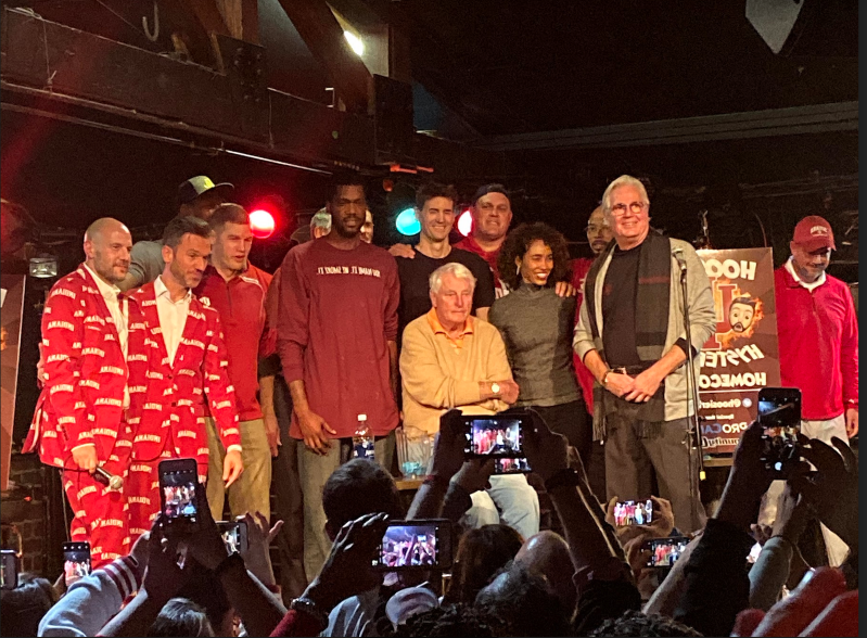 Bobby Knight et al. posing for the camera: Bob Knight (center) is flanked by former players and ESPN's Sage Steele (an IU alum) at The Bluebird in Bloomington on Saturday.