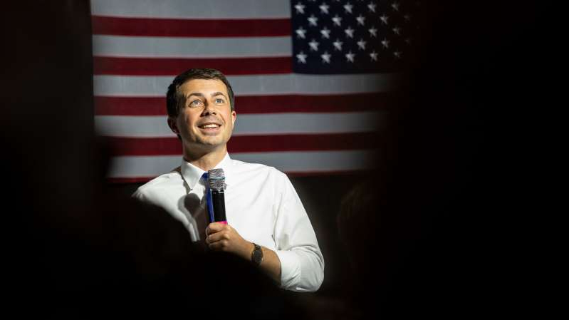 Peter Buttigieg wearing a suit and tie: Pete Buttigieg at a town hall in Ames, Iowa, last month.