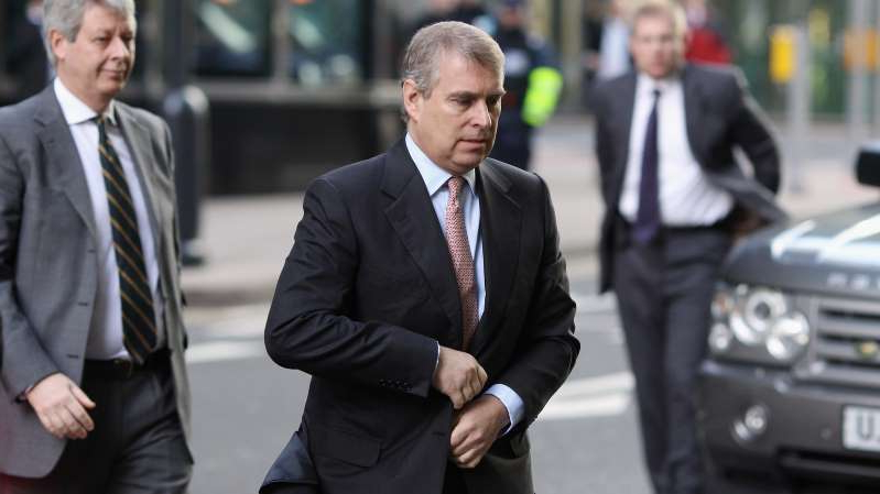 Prince Andrew, Duke of York wearing a suit and tie walking down the street: Prince Andrew tried to explain his relationship with the financier and convicted sex offender Jeffrey Epstein, but it backfired.